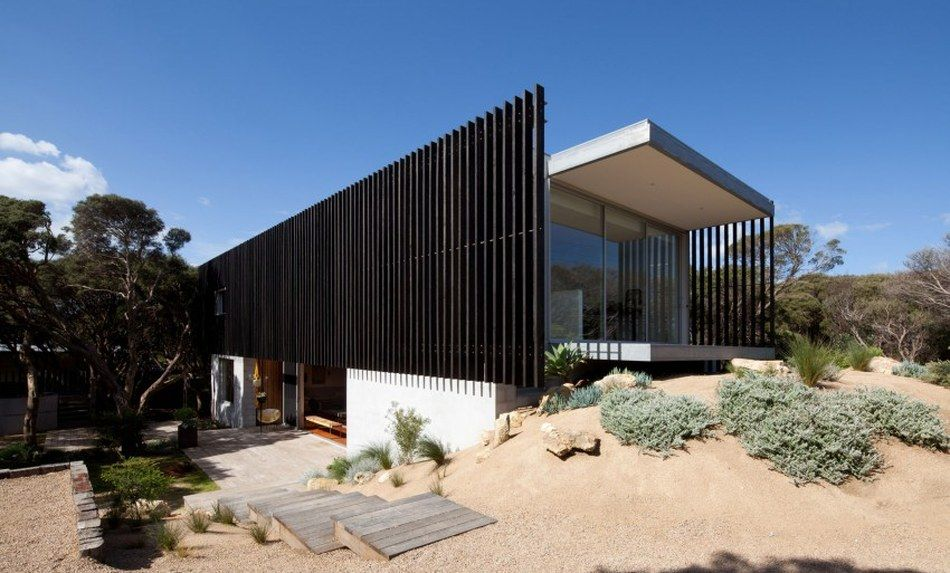 Maison contemporaine béton bardée de brise soleil en bois Facades