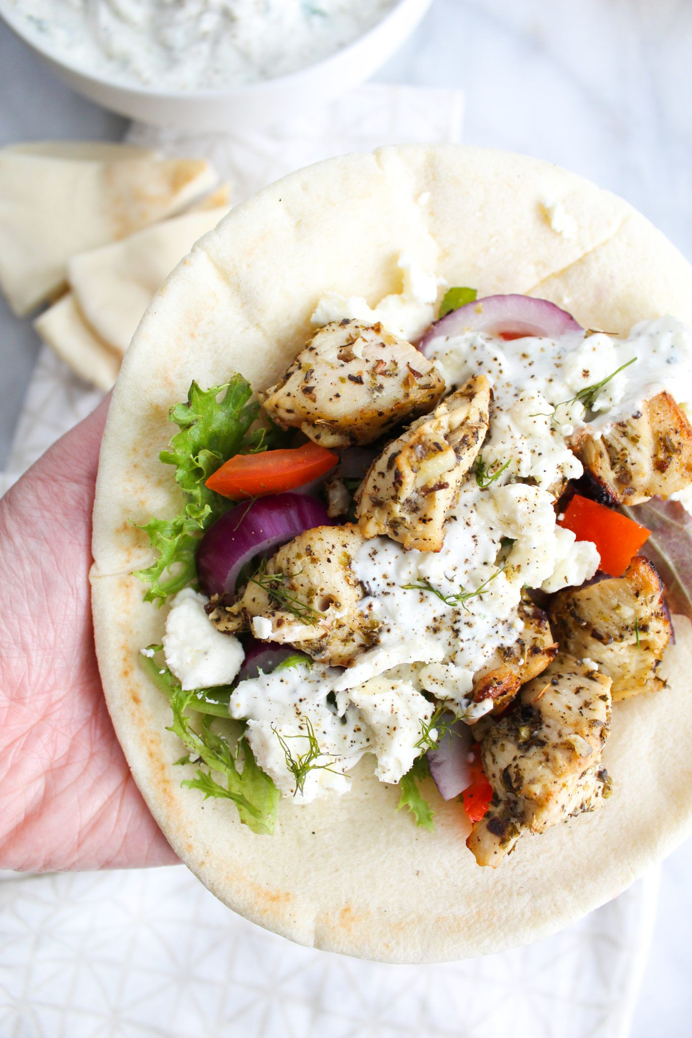 Super Close Up Chicken Souvlaki Pita In Hand Chicken Souvlaki Pita Chicken Slovaki Recipe Chicken Souvlaki