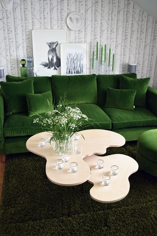 Green velvet sofa and Alvar Aalto-vase shaped tables by Erik Mäki, www.var-dags-rum.se    (so not Iittala official...)