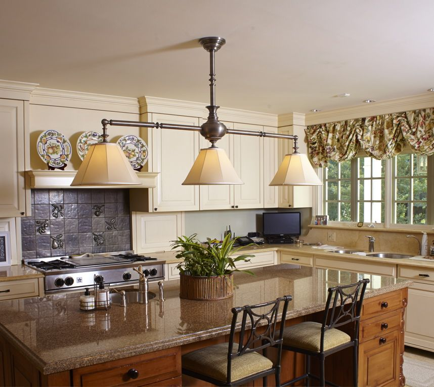 Traditional Kitchen Island Lit With A