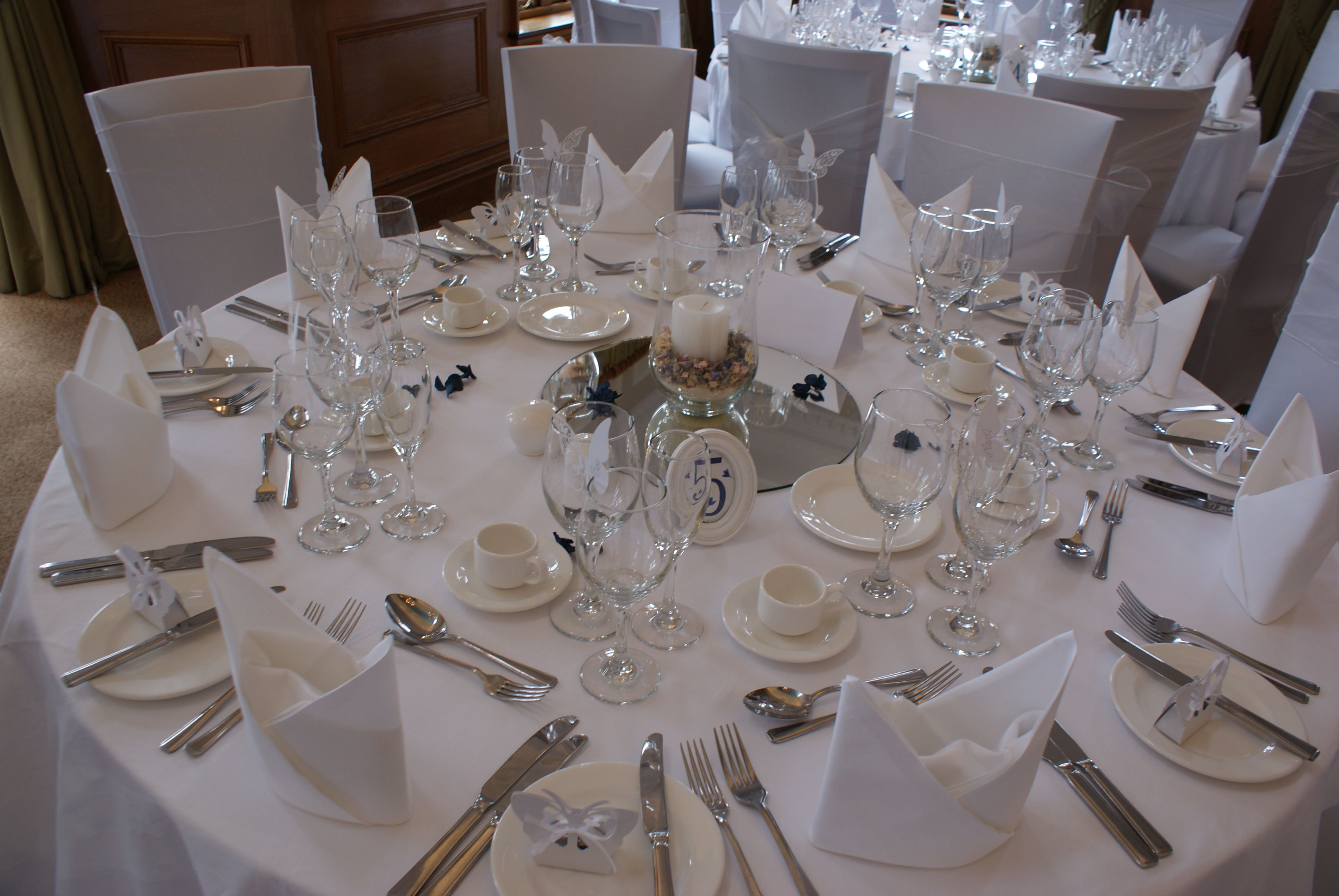 Round Wedding Table Set Up White Linen And White Chair