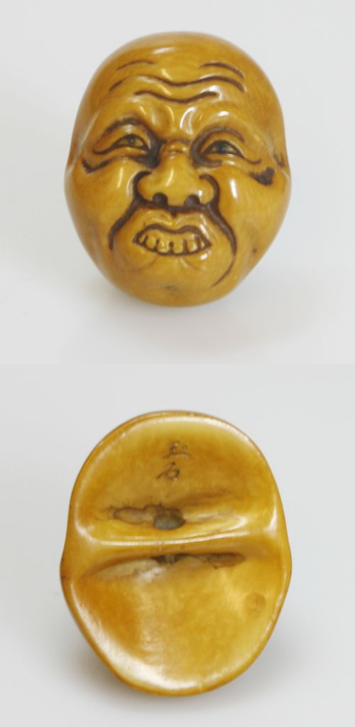 Netsuke of a mask made ​​of ivory, JAPAN, 1900-1950  beautiful orange-brown coloring, signed verso., H 4 - 150 EUR