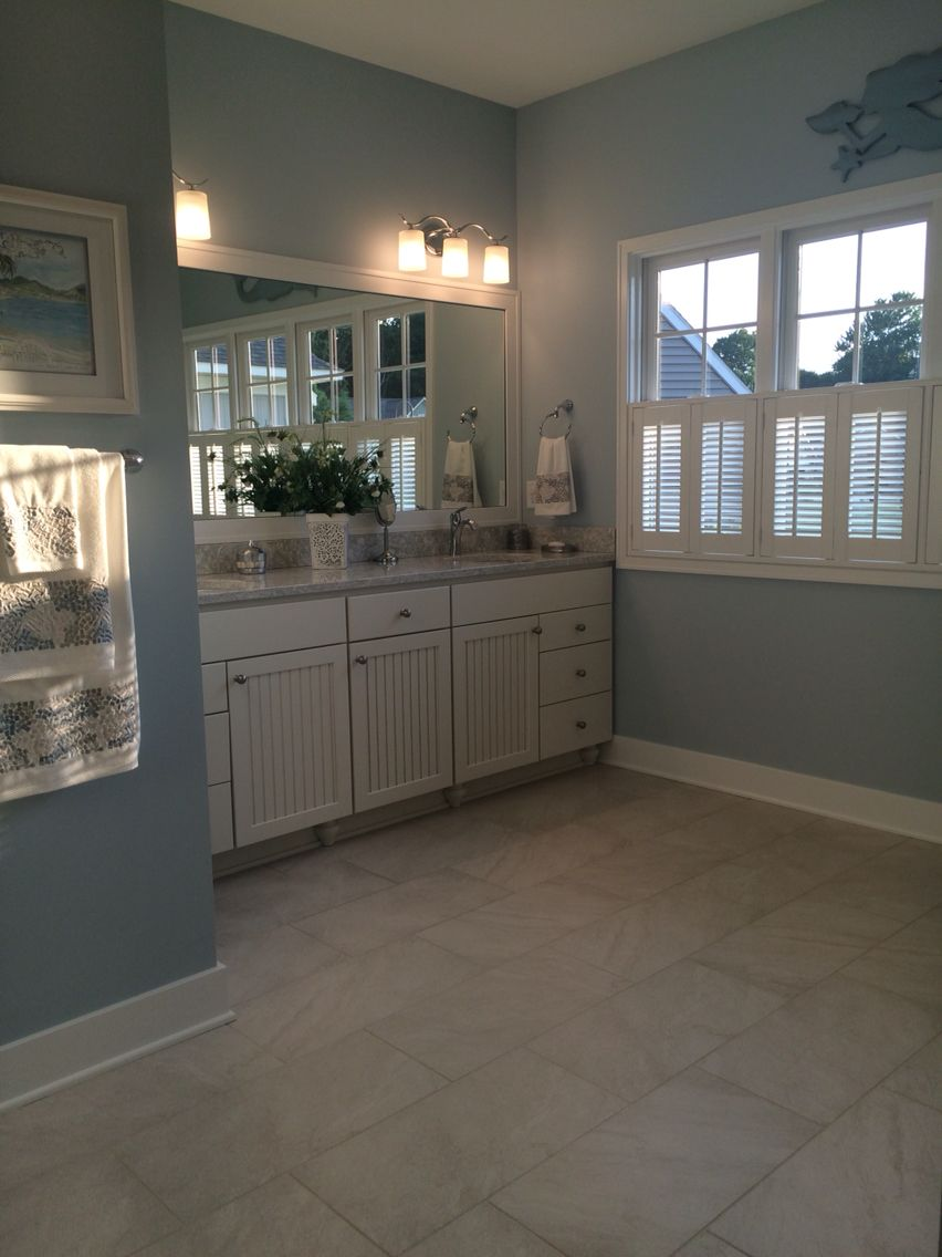 Beadboard cabinets in French vanilla, heated tile floor with 12 x 24 ...