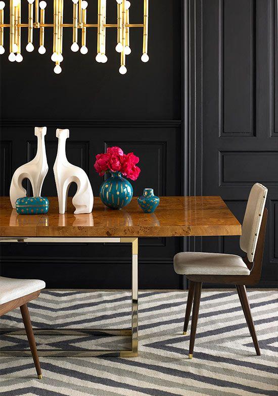Jonathan Adler Meurice Chandelier with a fabulous modern dining table.