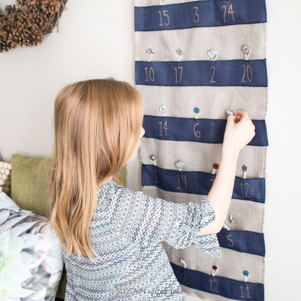 Make your own advent calendar with fabric and ribbon. A lovely handmade DIY Christmas keepsake idea.