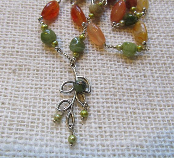 Organic design, silver leaf branch drop pendent necklace with fall color vintage beads.