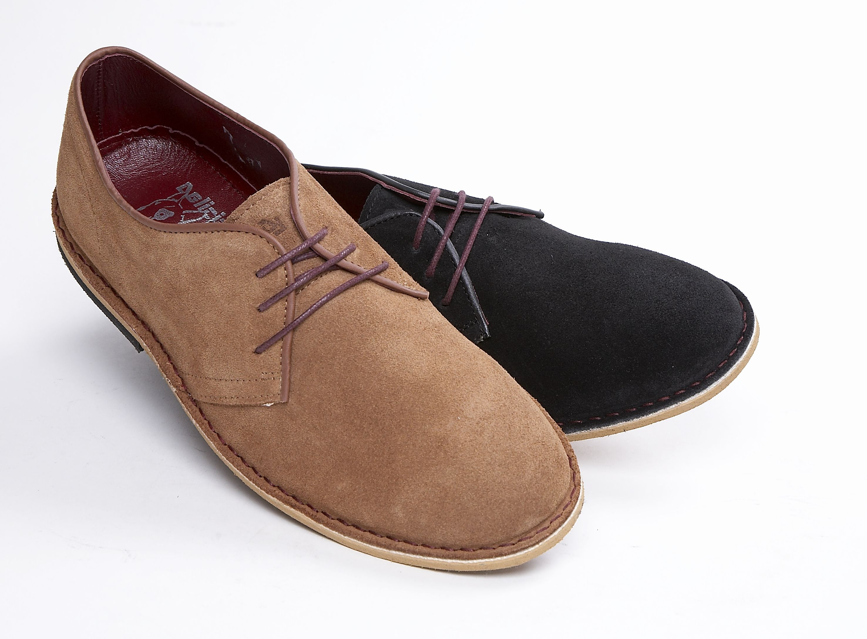 A cheeky two eyelet tie shoe, classic cut stitch down construction. Available in either jet black suede or hot ginger suede. Crimson leather linings and sock. New Delicious double dog-head design logo details  Hardwearing smooth oustole  £60.00