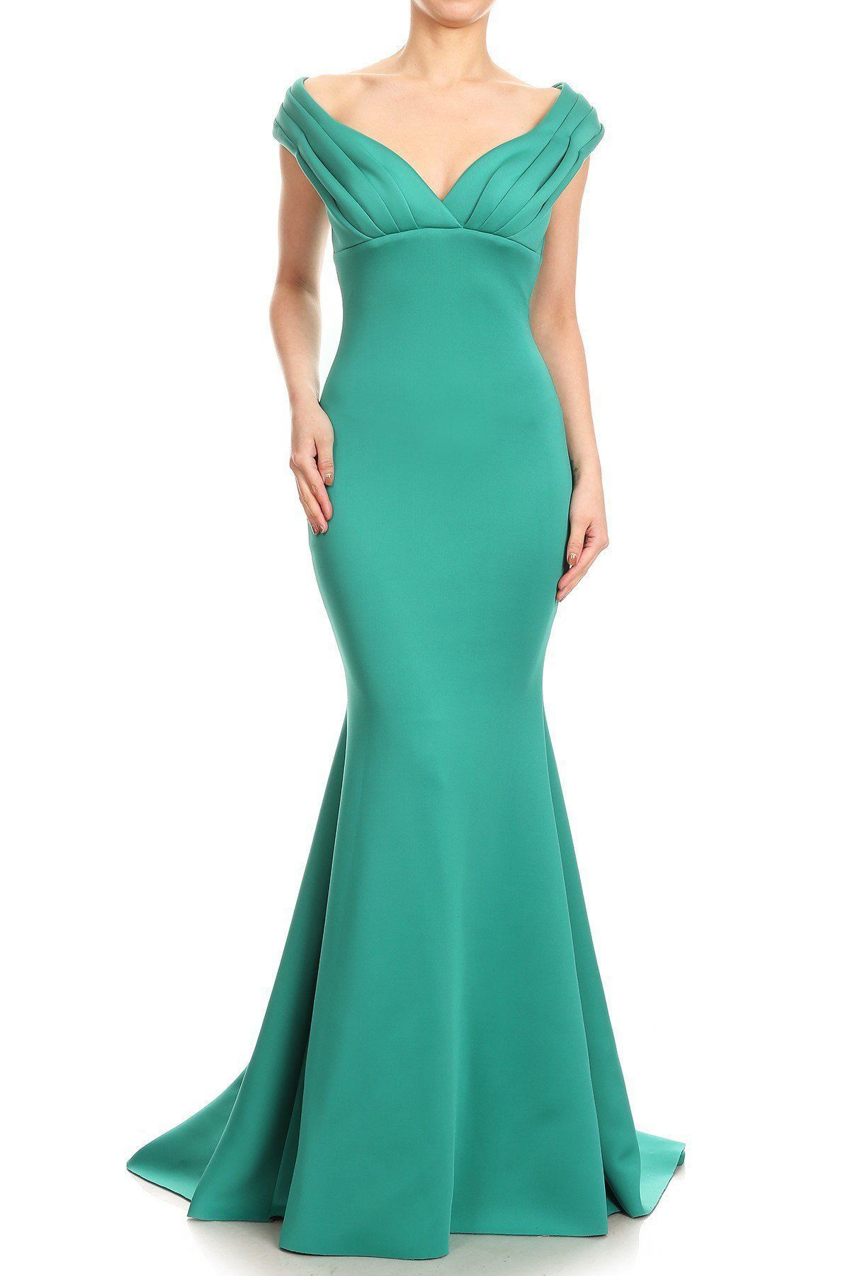 43b522095a94c Long structured evening gown featuring trumpet skirt and fitted bodice with  ruching on the bust.