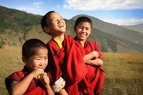 Three happy novice monks, Bhutan.