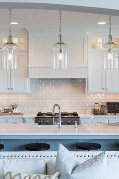 White Beveled Subway Tiles With White Shaker Cabinets Transitional Kitchen White Kitchen Design Glass Kitchen Kitchen Pendants