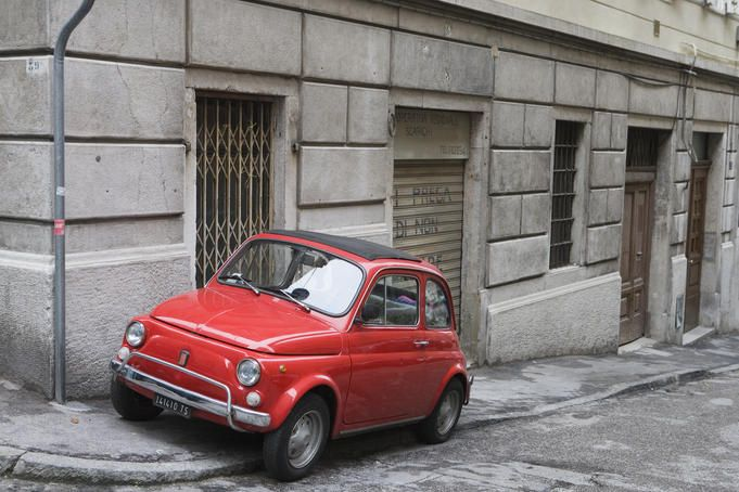 Adorable little Fiat Bambino brightening the back streets of Siena