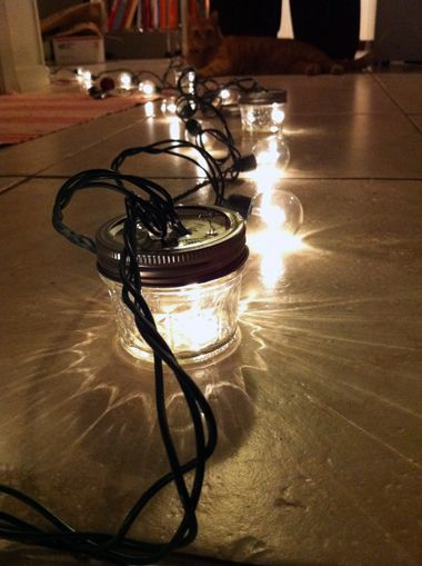 Squatty little mason jars and a string of twinkle lights = easy outdoor lighting.
