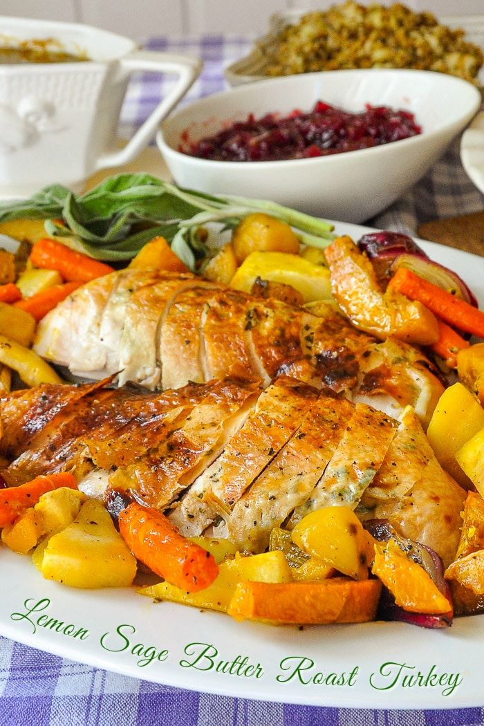 Lemon Sage Butter Roasted Turkey. Juicy and succulent, this sage butter roasted turkey with maple roasted vegetables makes a wonderful addition to a Thanksgiving table or any Sunday dinner. #christmasdinner #thanksgiving #howtoroastaturkey #turkeyrecipes