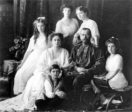 Photograph of the Russian Imperial Family, 1913. Left to right, seated: Grand Duchess Marie Nicholaevna; Tsaritsa Alexandra Feodorovna; Tsarevitch Alexei Nicholaevitch; Tsar Nicholas II; Grand Duchess Anastasia Nicholaevna Standing: Grand Duchess Tatiana, Grand Duchess Olga