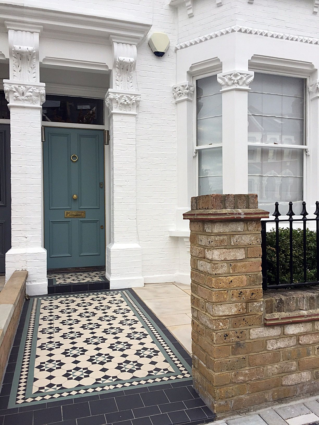 metal gate rails planting paving edwardian mosaic front modern garden design london fulham chelsea wandsworth contact anewgarden for more information
