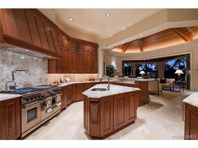 Naples Luxury Homes Blog Gourmet Kitchen With Center Island And Double Wolf Range Naples Fl Port Royal Indoor Outdoor Kitchen Home Kitchen Design