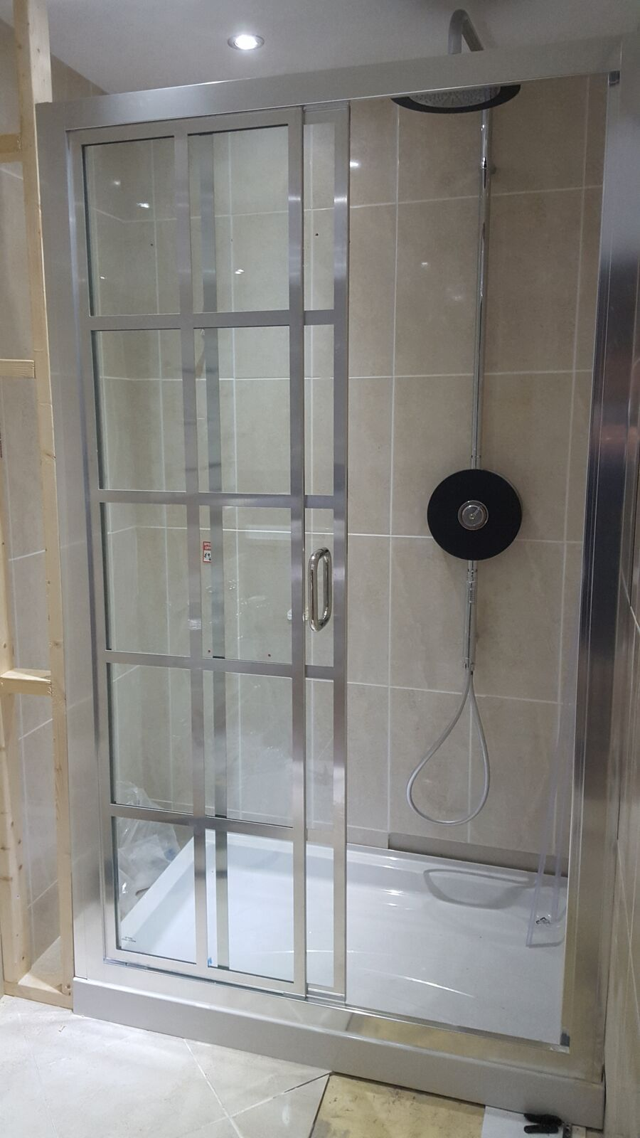 A Wonderful Grid Style Shower Enclosure With A Metal Finish For