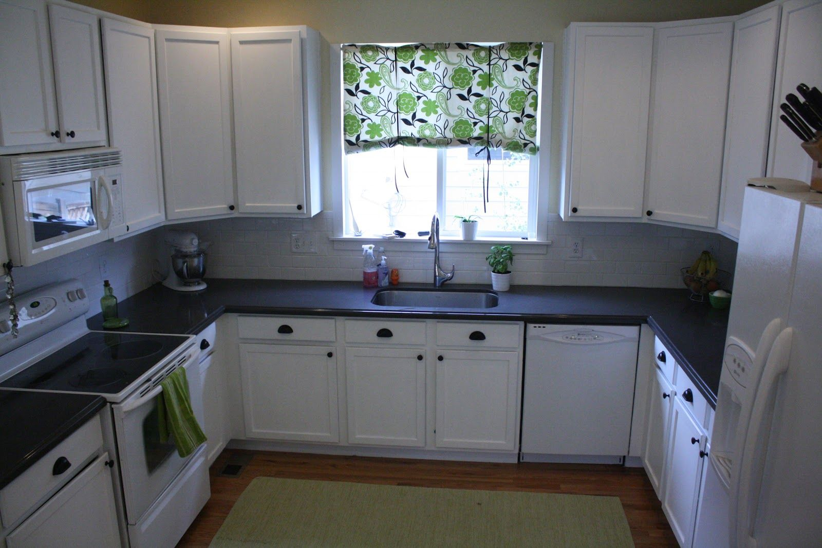 Image result for white kitchen with brown subway tile house ideas