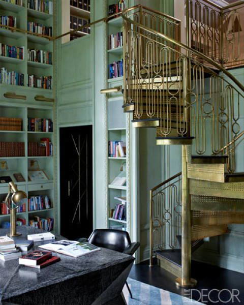 Kelly Wearstler designed the brass staircase in the library of this Mercer Island, Washington, home. The metallic hue brings a dose of glamour to the minty green walls. See more beautiful staircases.