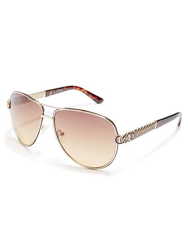 ef09e09c49bd The classic aviator made modern—these GUESS sunglasses are just what your  street-style