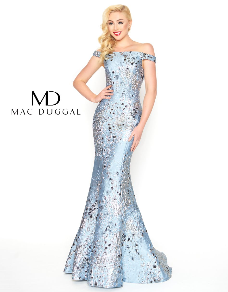 A sultry off the shoulder form fitting printed evening gown