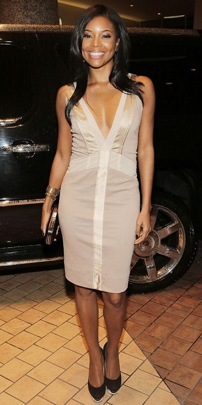 NOVEMBER 2013 Gabrielle Union WHAT SHE WORE Union flaunted her figure in a  plunging nude sheath dress with satin panels.