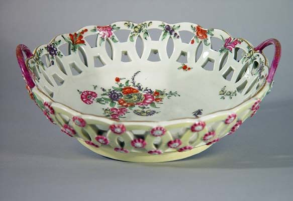 A First Period Worcester Porcelain Yellow-Ground Reticulated Botanical Circular Basket, 1770