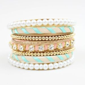 """As seen on ShopDesignSpark.com  Girlie and flirty candy on your wrist.    -gold metal, pearls, fabric, crystals  -3""""w  -imported"""
