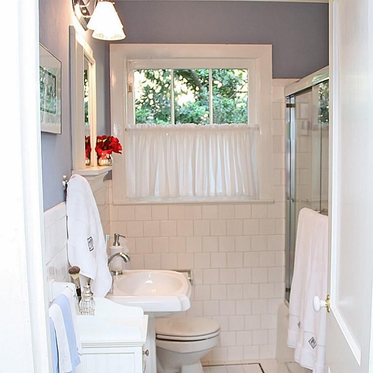 Full bath has tub/shower combo and pedestal sink.