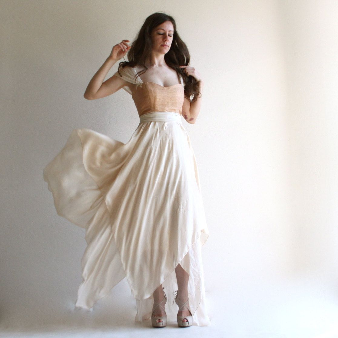 This fairy wedding gown features a romantic corsetted bustier and a ...