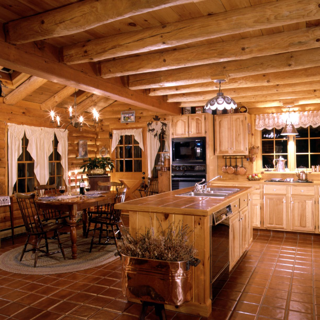Log Home Kitchen ~ warmth of tiles for island counter and floors ...