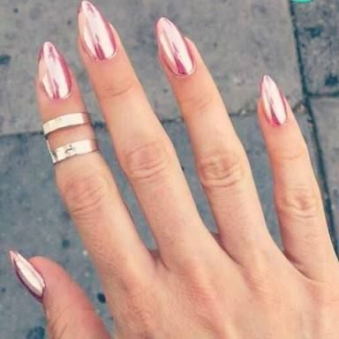 Rose gold chrome nails.  Perfect almond shape and length.