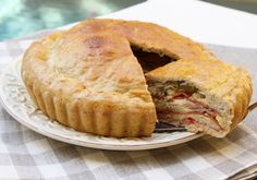 """Pizza Chena is a southern Italian savory """"pie"""" made with a variety of cheese, cold cuts, and eggs baked within a bread crust. Often made for Easter Monday picnics!"""