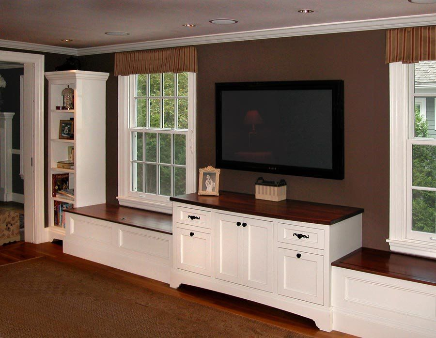 Mahogany Tops On Window Seats Flank Entertainment Center Cabinet