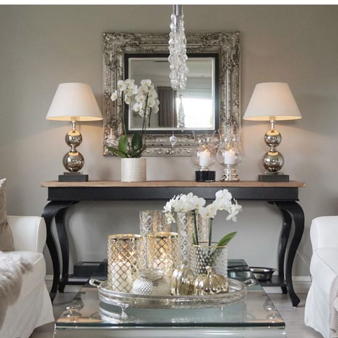 Don't be afraid of a nice glass or mirrored coffee table ...