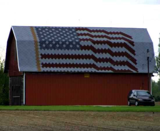 shingled roof with american flag
