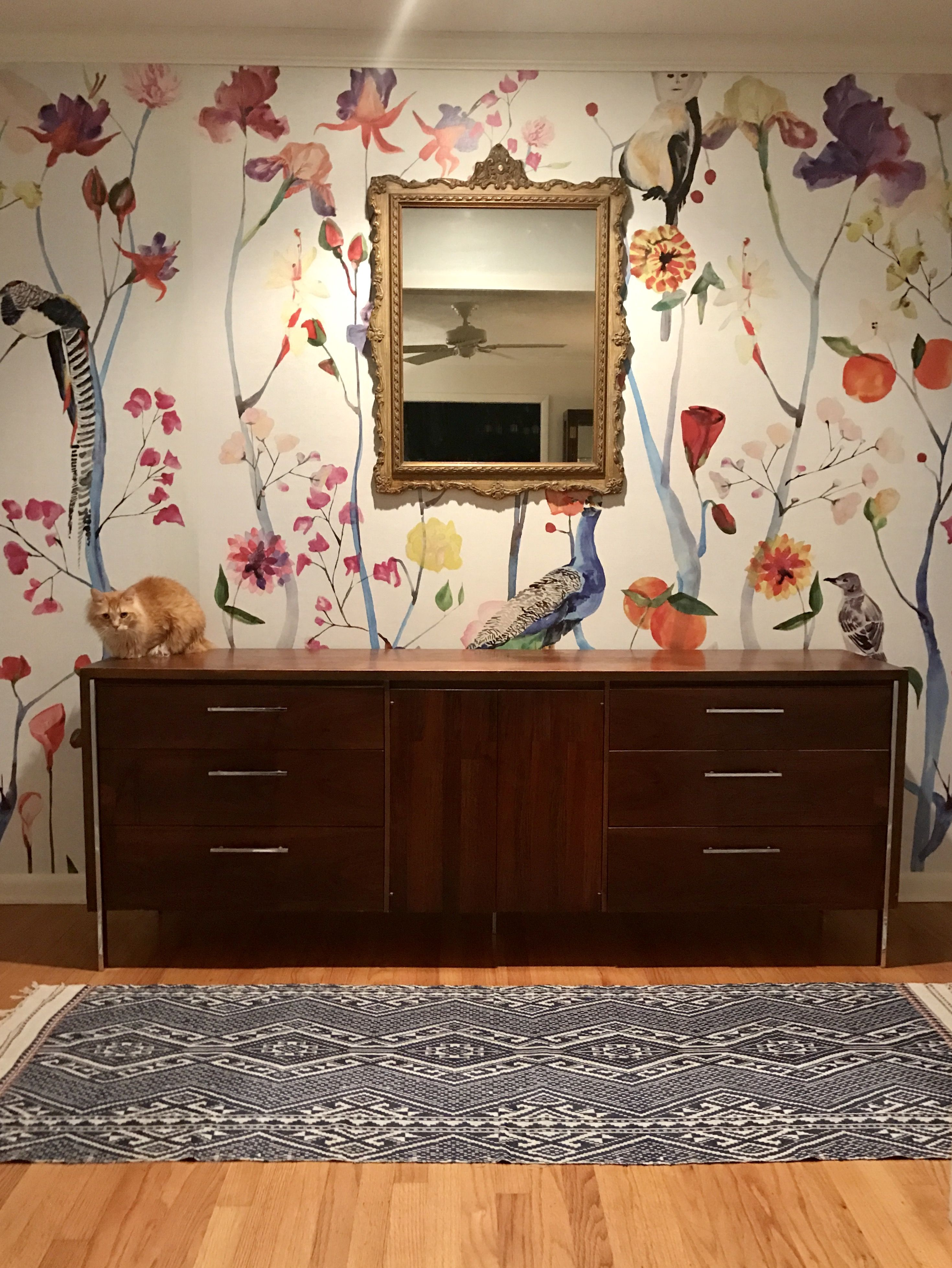 Foyer with Antropology Wallpaper Mural and mid century modern credenza