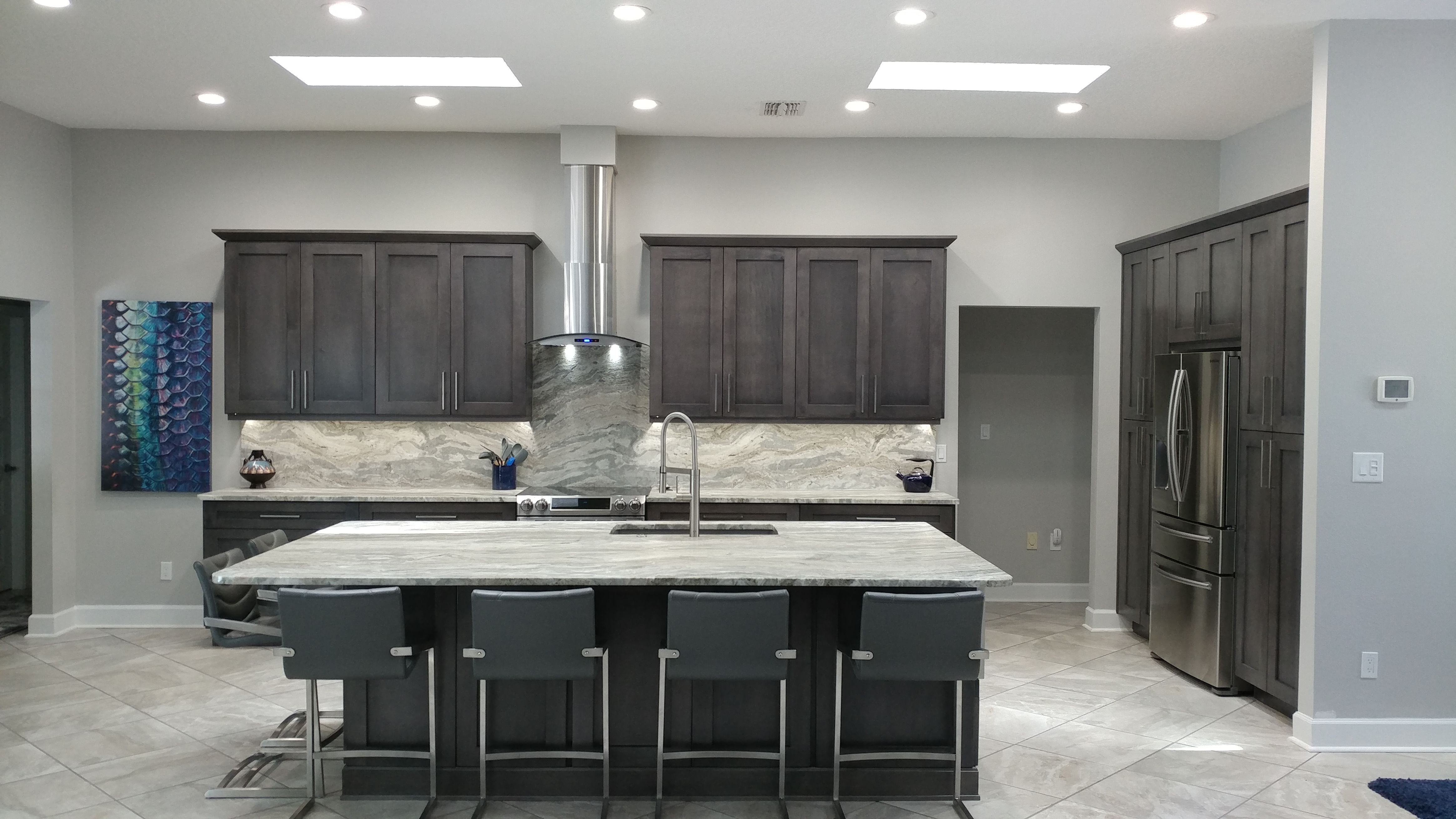 The Soothing Pallet Of Slate Shaker Cabinets By Eudora And Fantasy Brown Quartzite With A Leather Finish Make This Home A Shaker Cabinets Slate Kitchen Cabinet