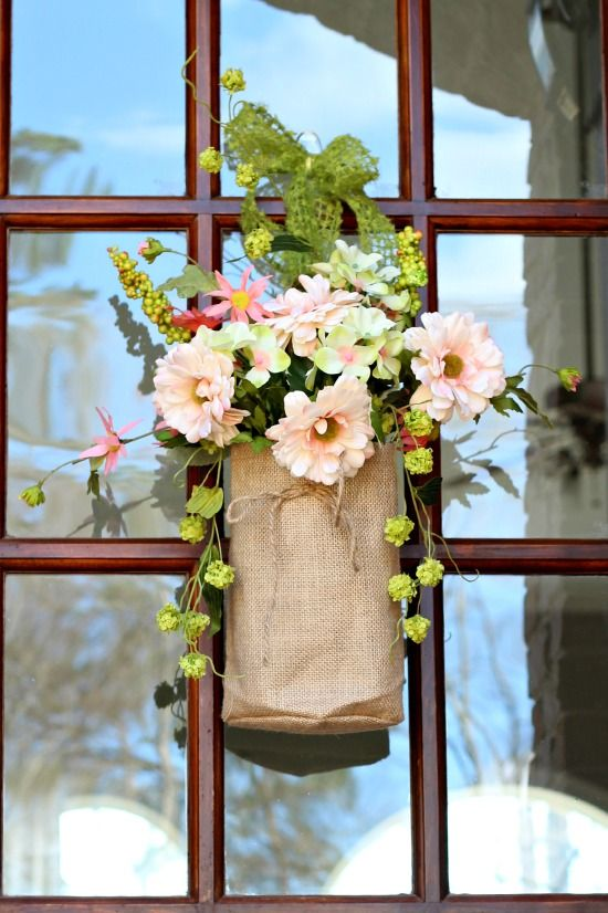 Don't just put a wreathe on your door! Use Corals, greens, pinks flowers in burlap bags.