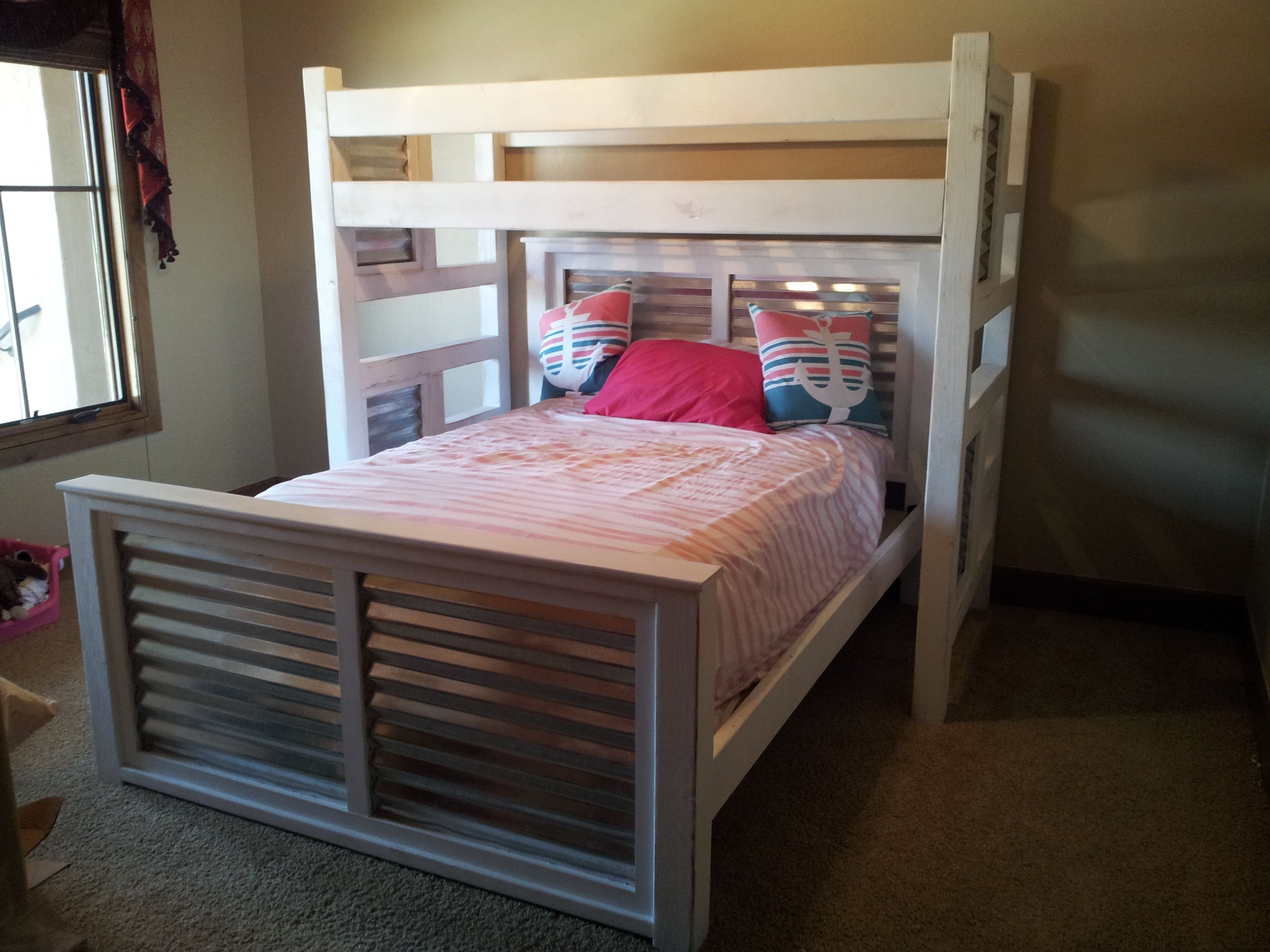 Custom built Twin Loft over a Queen with inset tin on head