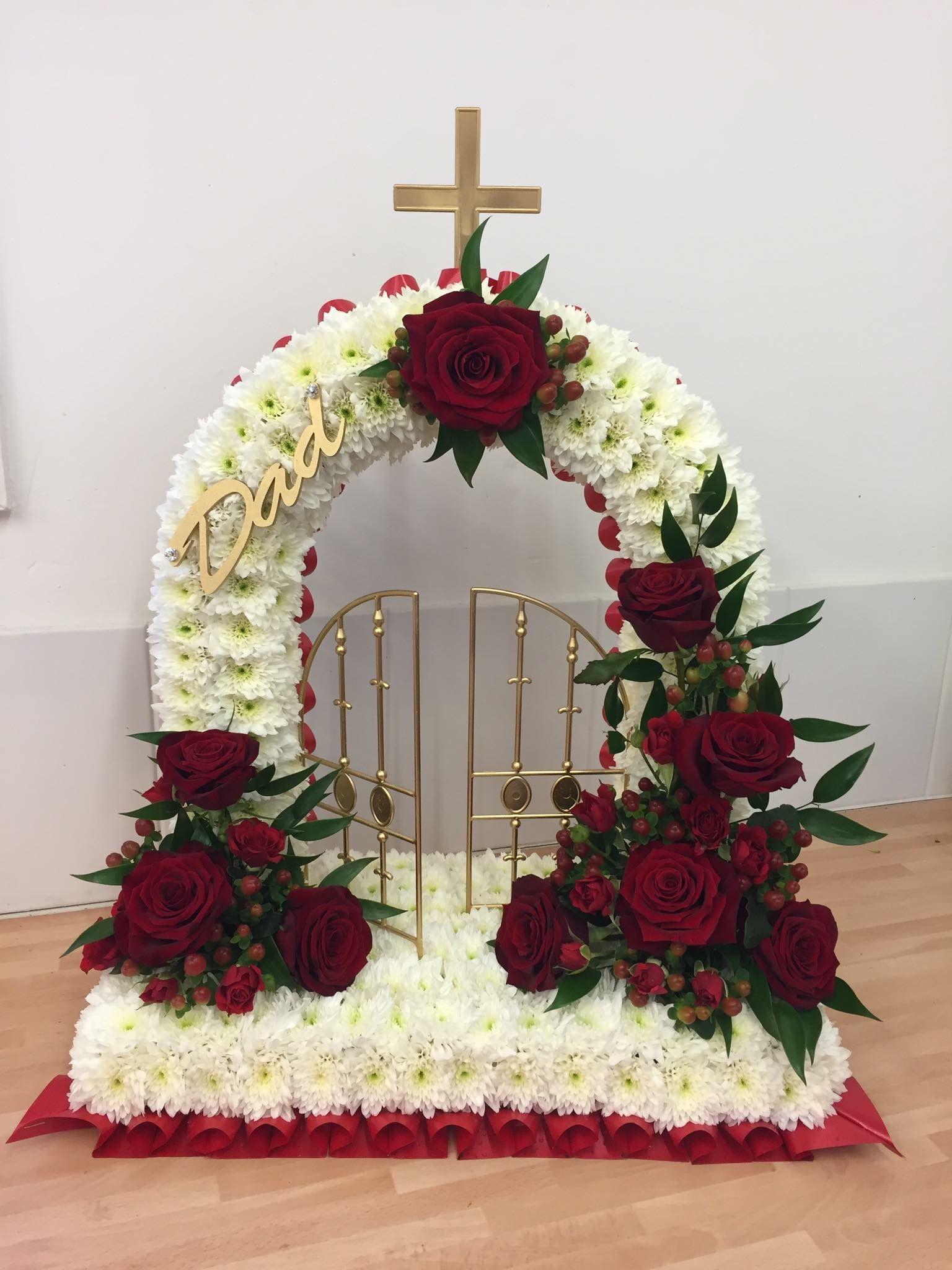 White based gates of heaven funeral tribute with red rose sprays and white based gates of heaven funeral tribute with red rose sprays and gold accented dad plaque izmirmasajfo