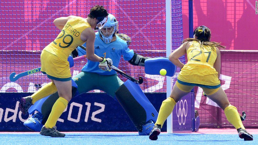 China S Zhang Yimeng Center Saves A Shot From Australian Teneal Attard Left As Australia Vs China Attard S Teamm Womens Field Hockey Olympics Olympic Team