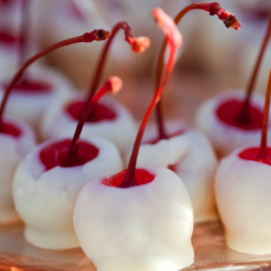 white chocolate dipped cherries or strawberries