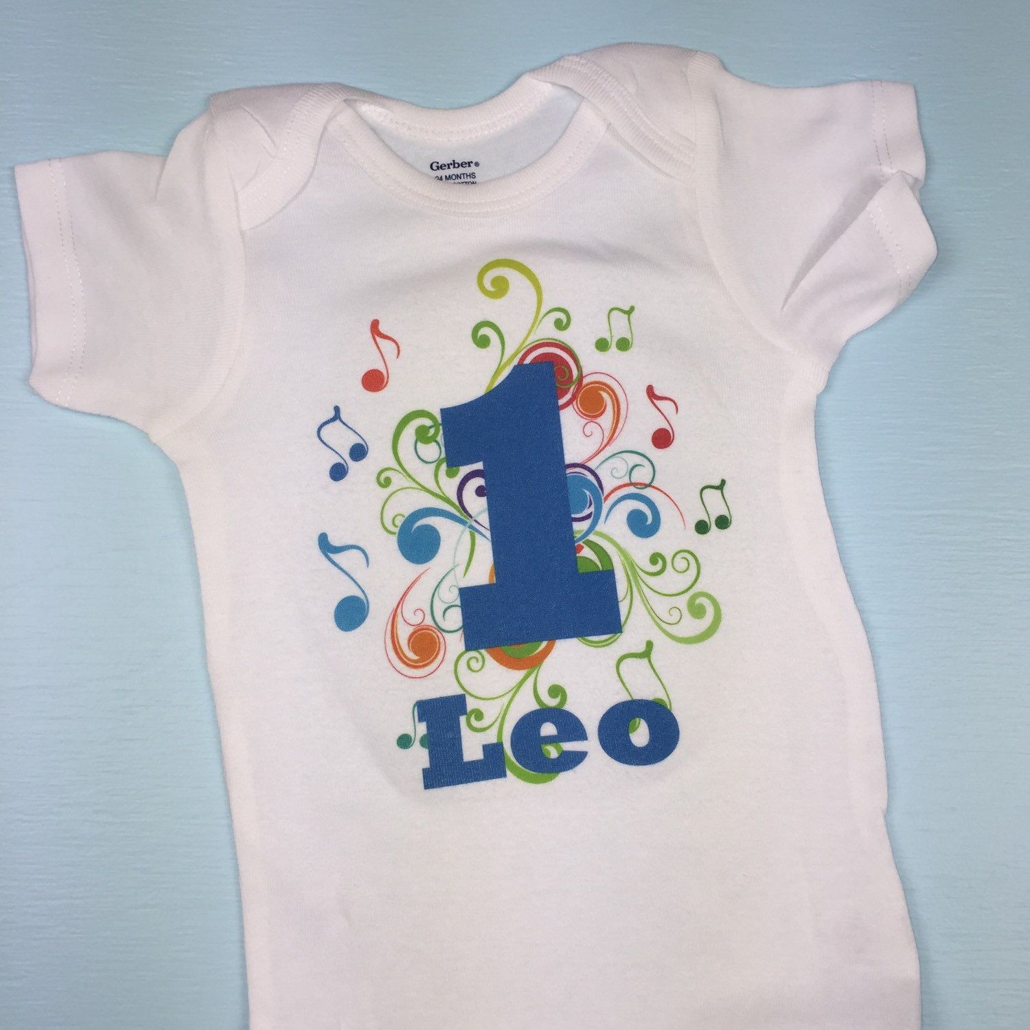 c46ada5970712 Boy s music themed birthday Onesie outfit. Personalized with your child s  name. Find this Pin and more on 1 year old ...
