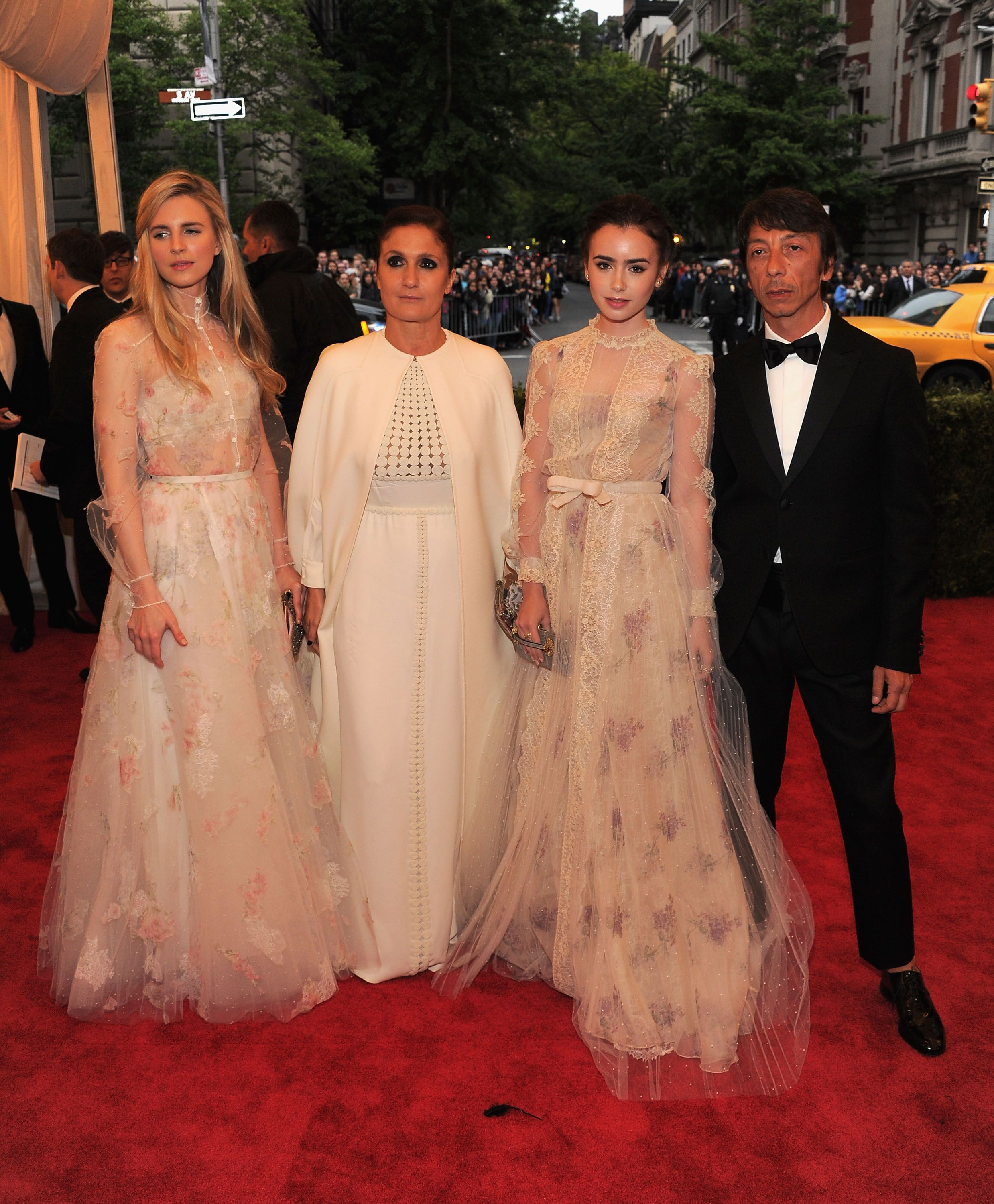 Creative Designers Maria Grazia Chiuri and Pierpaolo Piccioli with Birt Marling and Lily Collins at the Met Ball, both wearing Valentino Haute Couture gowns from SS 2012