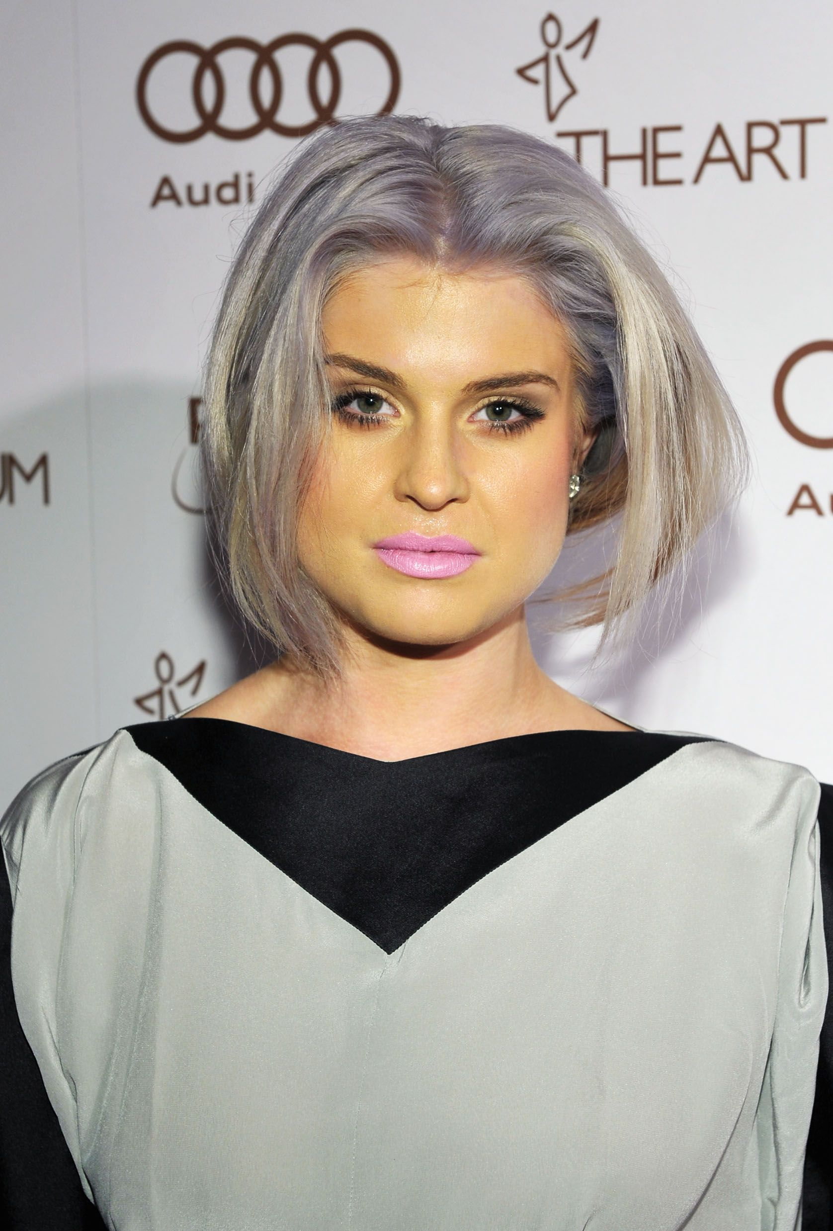Kelly Osbourne is greenish... Bad makeup ruins everything