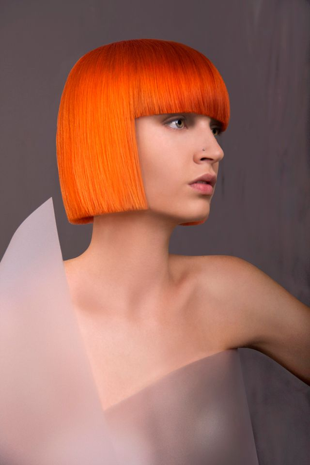 Short orange bob.....reminds me of the fifth element