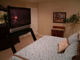 Automatic TV Stand that goes under your bed bedroom from CRIBCANDY