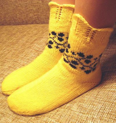 Photo of yellow knitted sock patterns