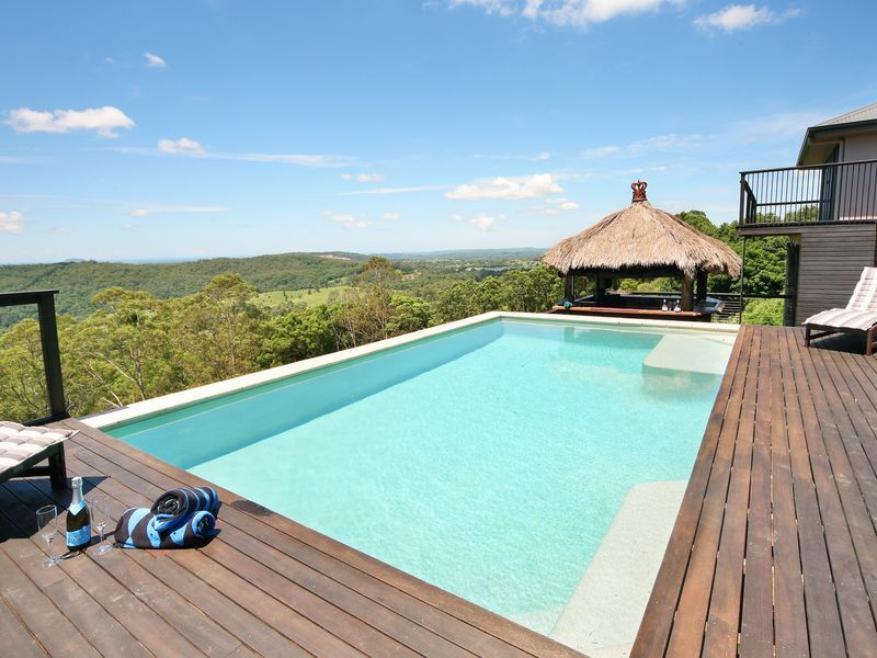 Outdoor suspended pool surrounded by deck that view for Pool builders queensland
